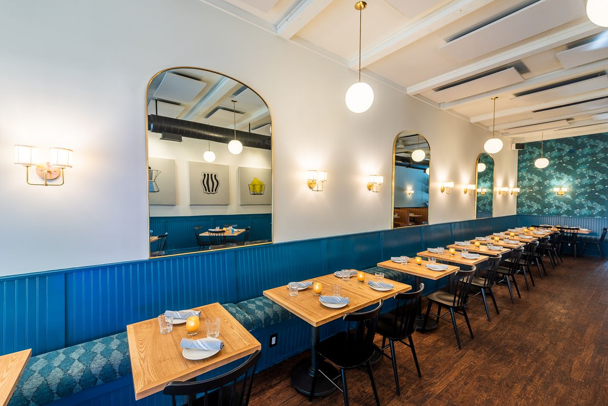 Mirrors and metal lamps line the walls at Thompson Italian.