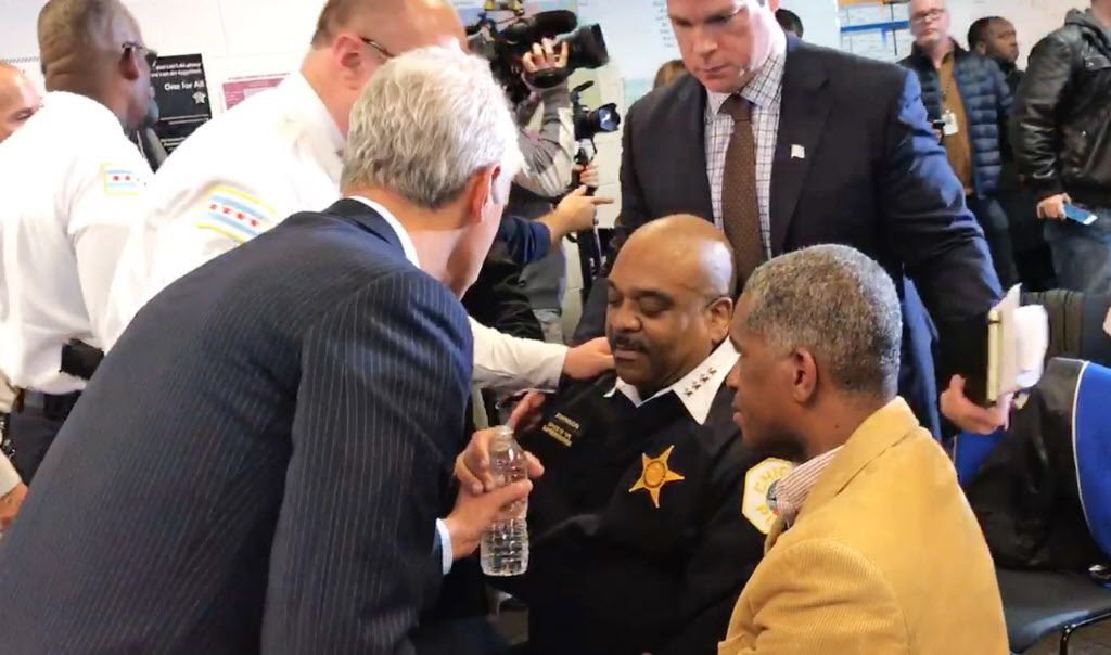 Mayor Rahm Emanuel, seen handing a bottle of water to Supt. Eddie Johnson after Johnson fell ill during a news conference last month to announce the expanded use of ShotSpotter.   Fran Spielman / Sun-Times
