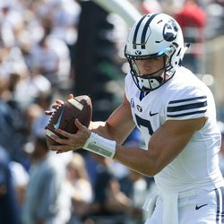 Brigham Young Cougars quarterback Beau Hoge (7) warms up before the game against the Wisconsin Badgers at LaVell Edwards Stadium in Provo on Saturday, Sept. 16, 2017.