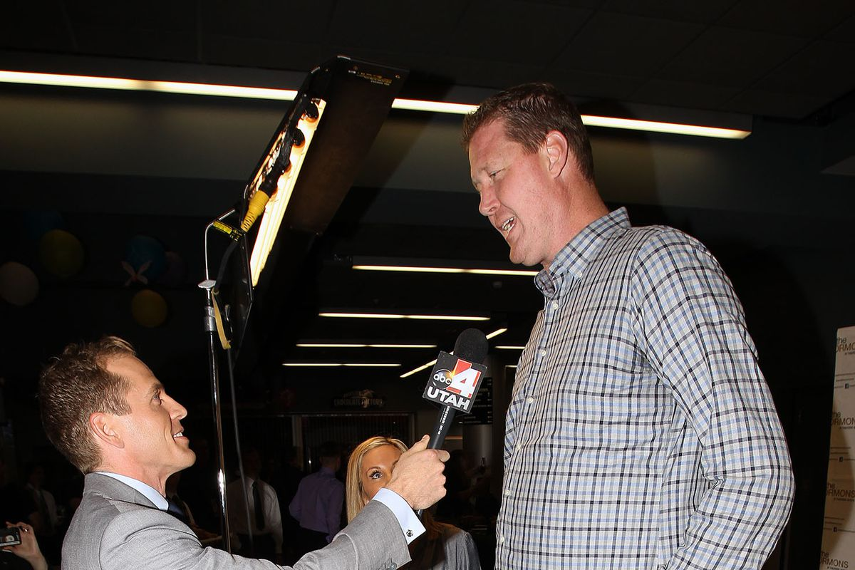"""Shawn Bradley and his wife Annette talk with members of the media as the """"Meet the Mormons"""" movie premieres Tuesday, Oct. 7, 2014, at Jordan Commons in Sandy."""