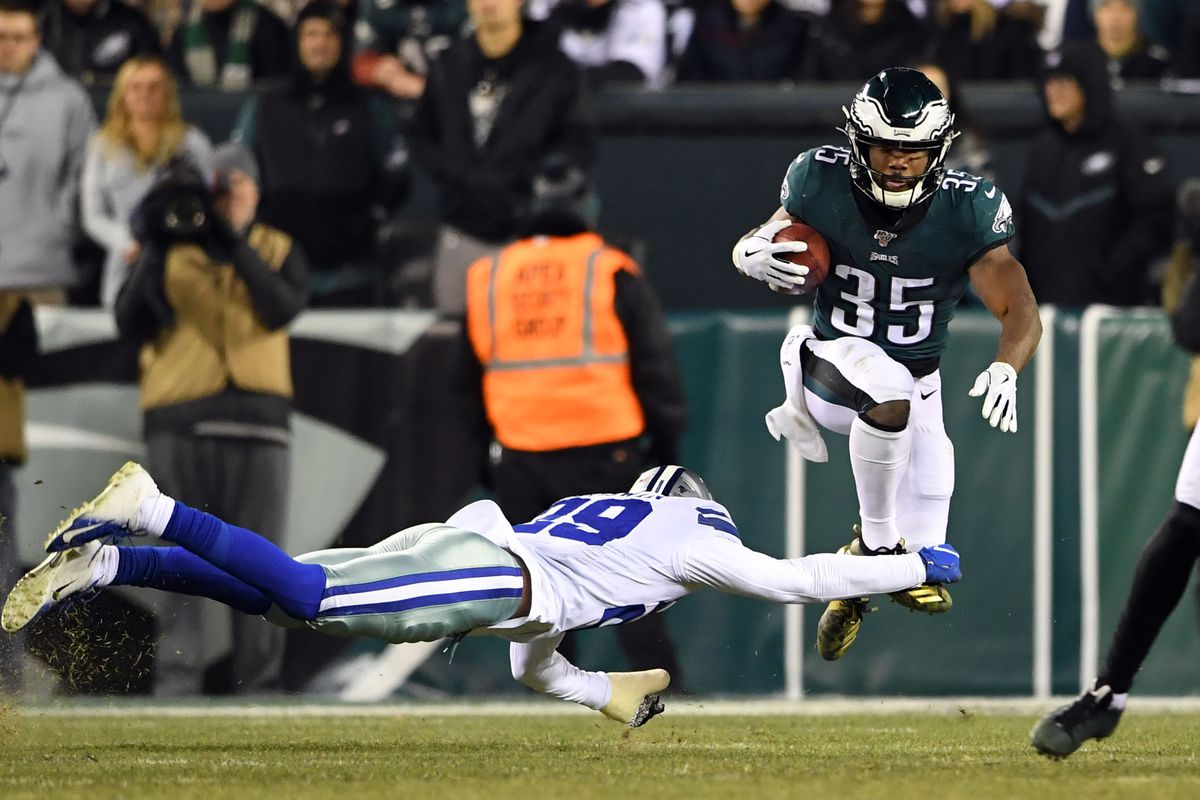 Philadelphia Eagles running back Boston Scott leaps over a tackle by Dallas Cowboys defensive back C.J. Goodwin during a kick return in the fourth quarter at Lincoln Financial Field.