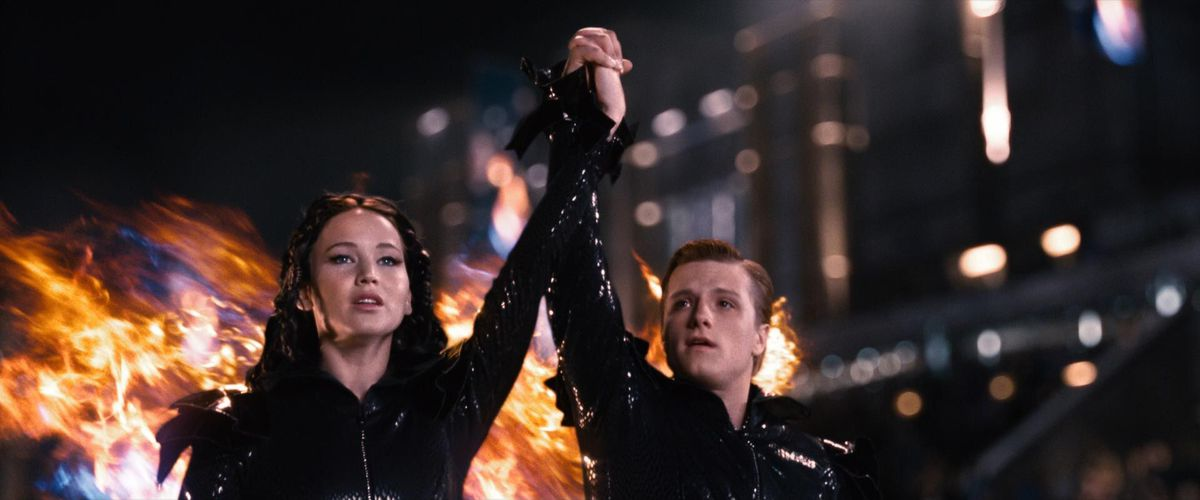 katniss and peeta on fire in the first hunger games movie