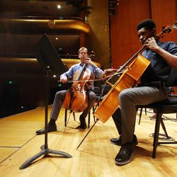 Getro Joseph, a young cellist from Haiti, right, plays with John Eckstein of the Utah Symphony as the two have a short practice session at Abravanel Hall in Salt Lake City on Saturday, Dec. 7, 2019. Getro also met with Congressman Ben McAdams, who assisted Getro with the visa process for his trip to Utah.