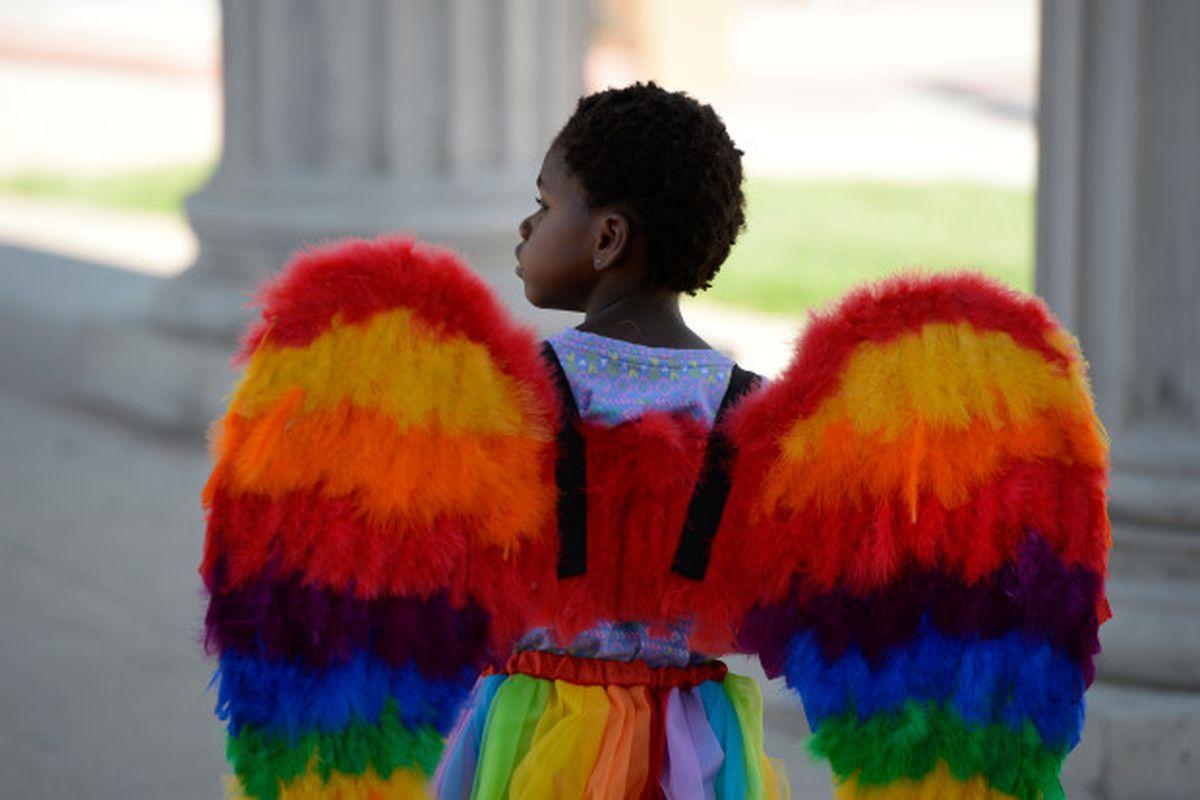 Ellie Ozbayrak, 4, sports rainbow wings at the annual PrideFest celebration at Civic Center Park June 18, 2016.