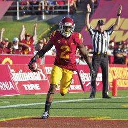 Adoree' Jackson runs to celebrate his first career USC touchdown.