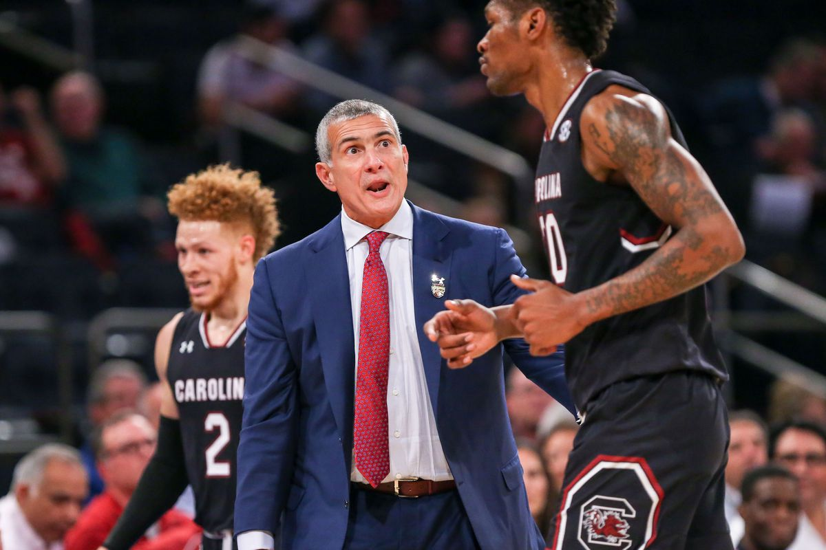 Nov 30, 2017; New York, NY, USA; South Carolina Gamecocks head coach Frank Martin talks to guard Tommy Corchiani (20) during the first half of the Under Armour Reunion at Madison Square Garden. Mandatory Credit: Vincent Carchietta-USA TODAY Sports