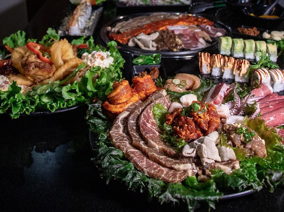 Korean barbecue and sushi on platters