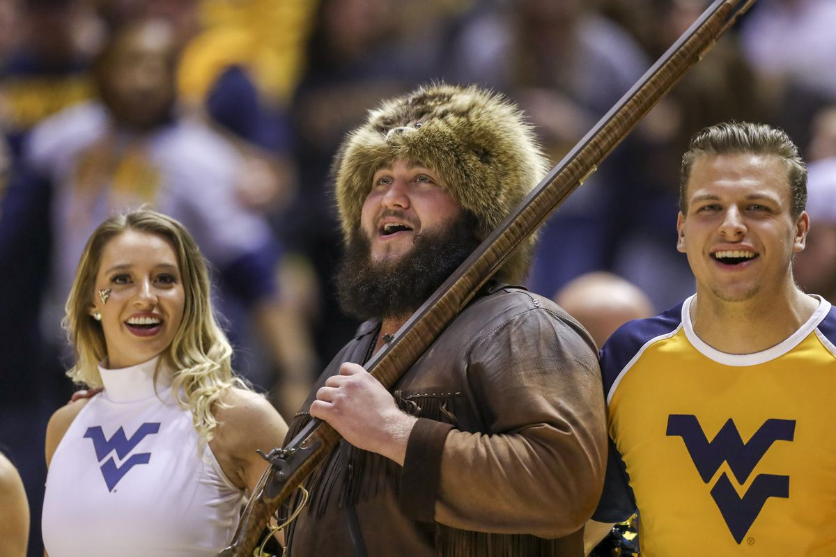 """The West Virginia Mountaineers mascot sings """"Country Roads"""" after defeating the Texas Longhorns at WVU Coliseum."""