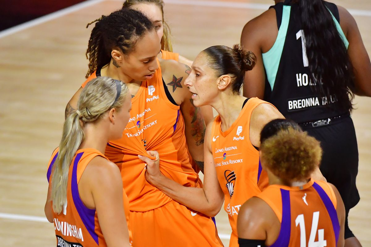 Diana Taurasi grabs the jersey of Brittney Griner of the Phoenix Mercury after a foul during the second half of a game against the New York Liberty at Feld Entertainment Center on August 02, 2020 in Palmetto, Florida.