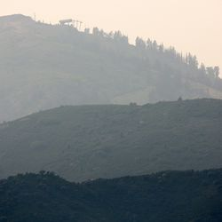 Smoke in the mountains as crews continue fighting the Parleys Canyon Fire near Park City on Sunday, Aug. 15, 2021.