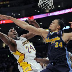 Los Angeles Lakers guard Kobe Bryant, left, puts up a shot as Denver Nuggets center JaVale McGee defends during the first half of an NBA first-round playoff basketball game, Sunday, April 29, 2012, in Los Angeles.