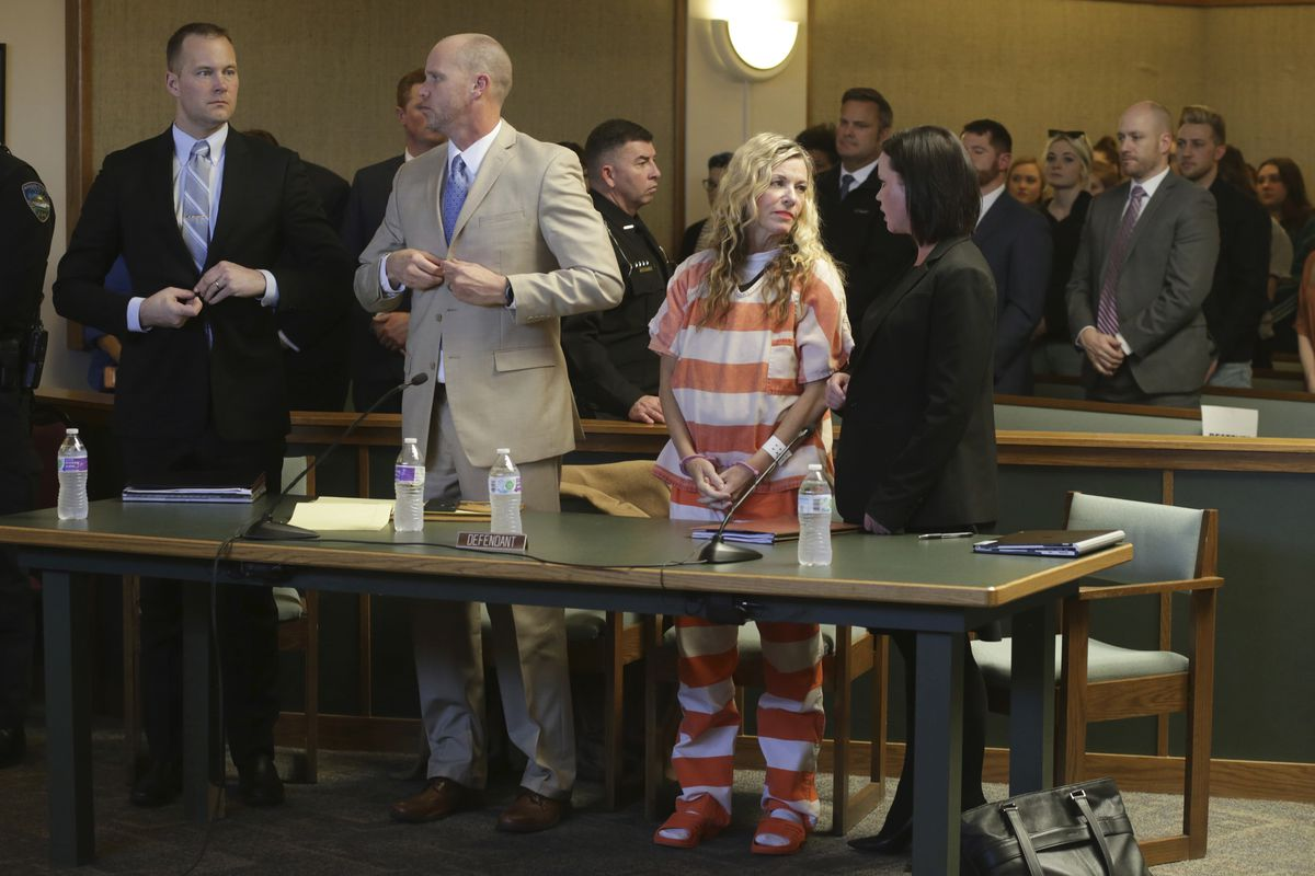 Lori Vallow Daybell, front, second right, and her defense team wait to leave the courtroom during her hearing on Friday, March 6, 2020, in Rexburg, Idaho. Daybell who is charged with felony child abandonment after her two children went missing nearly six months ago had her bond reduced to $1 million by an Idaho judge on Friday.