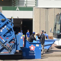 11:04 a.m. Trash being hauled away from Gate A before the game -