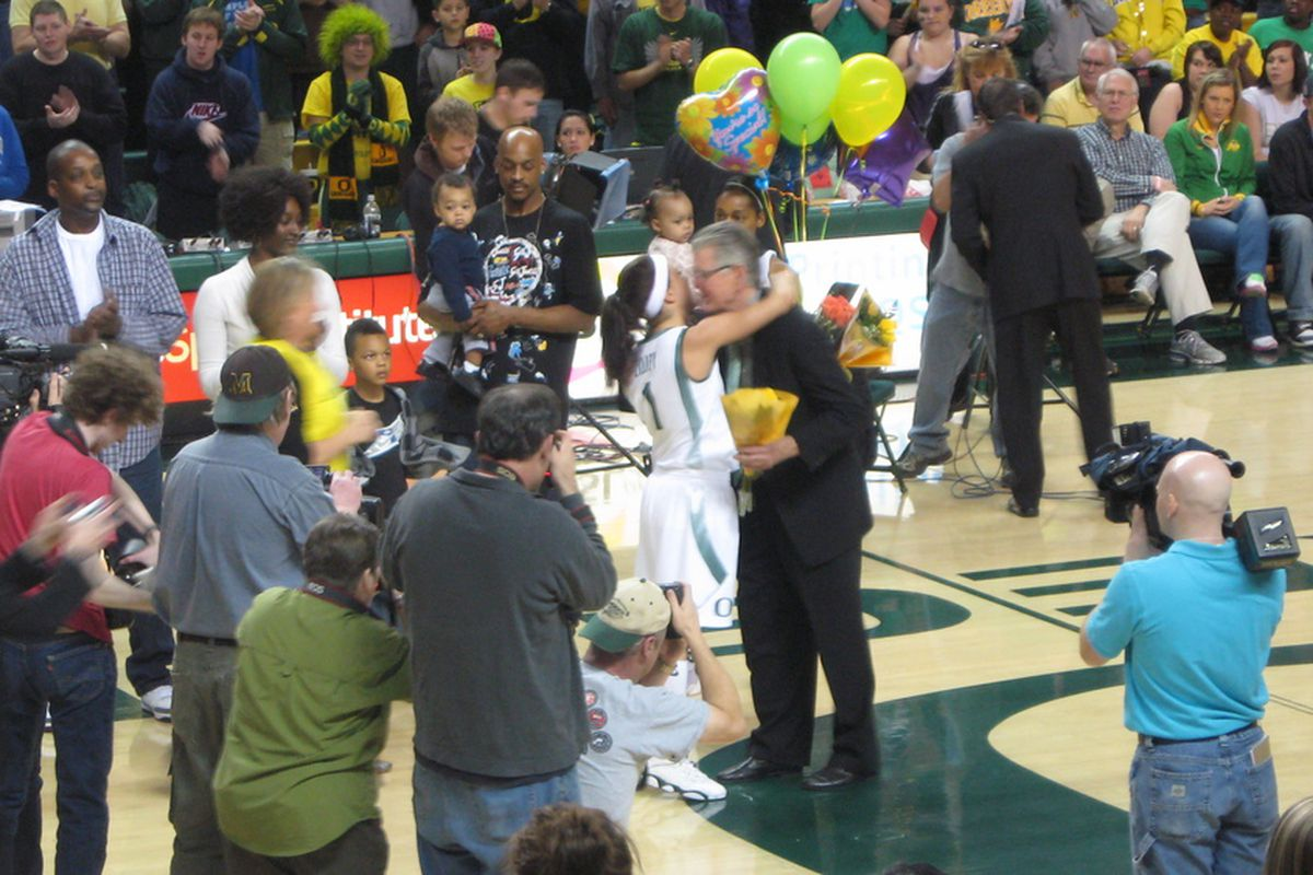 University of Oregon senior Taylor Lilley embraces coach Paul Westhead on Senior Day on Saturday. Lindsey Saffold (holding balloons) and Micaela Cocks (not pictured) were also honored.