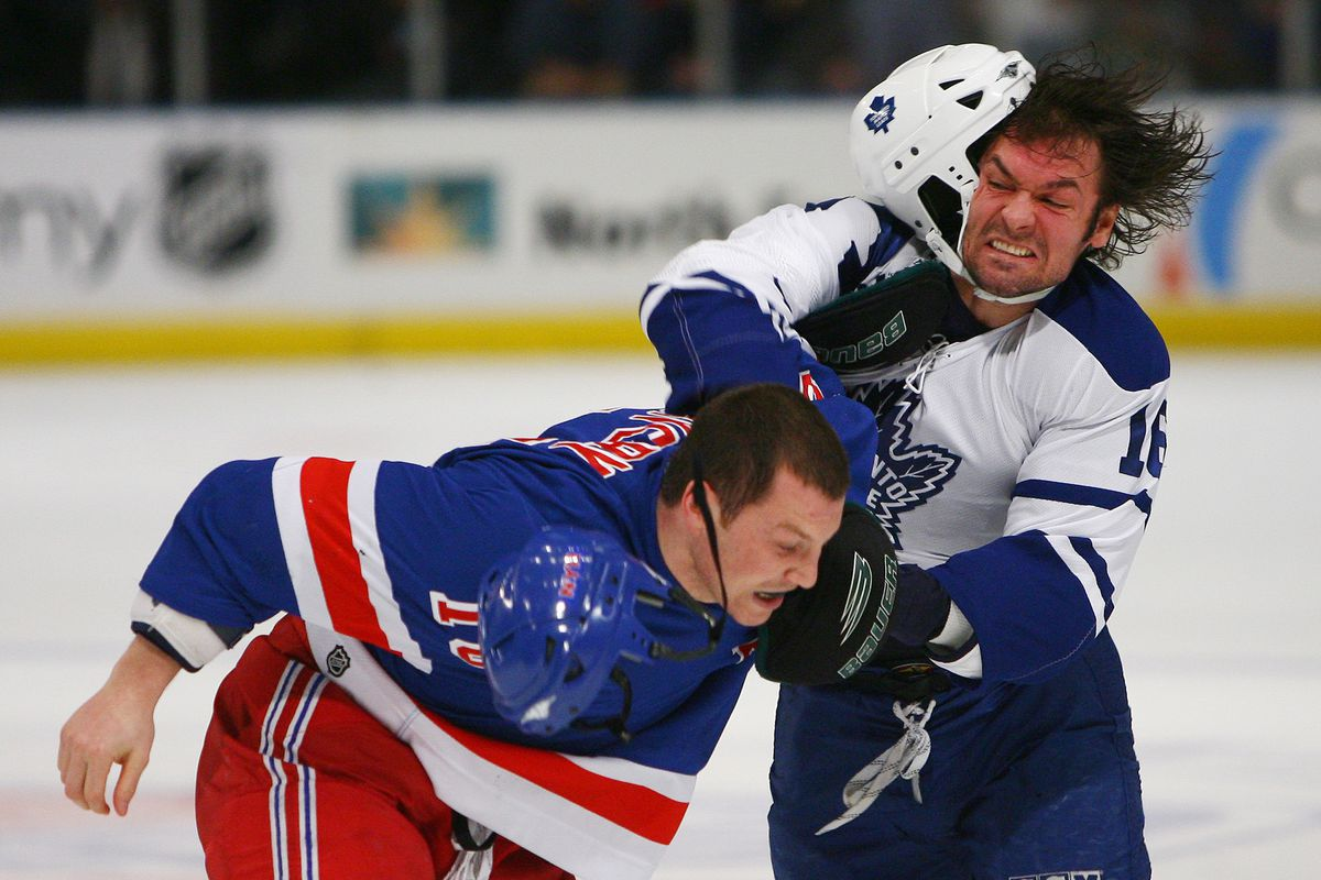 Toronto Maple Leafs' Darcy Tucker (right) connects with a pu