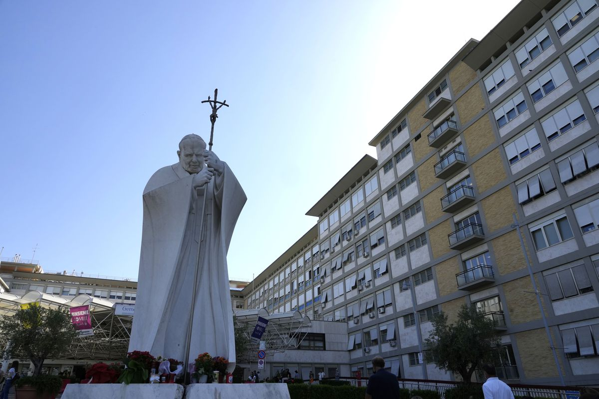 The statue of Pope John Paul II is seen at the entrance of the Agostino Gemelli Polyclinic in Rome, Wednesday, July 7, 2021, where Pope Francis was hospitalized Sunday.