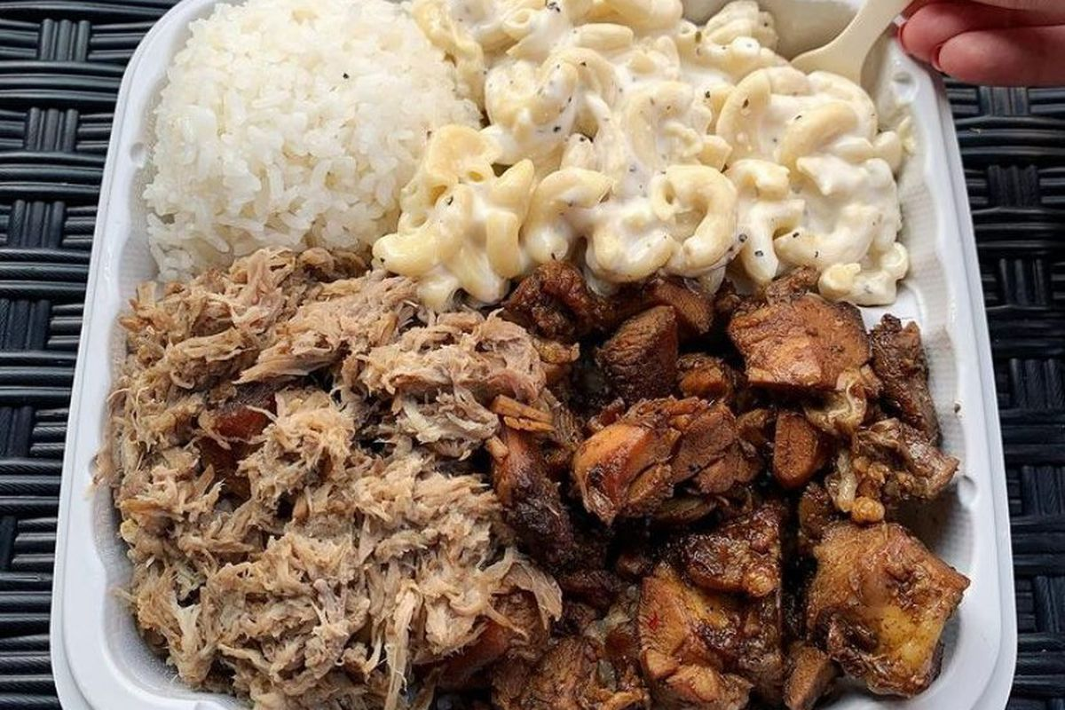 a Hawaiian-style plate lunch in a takeout container including white rice, macaroni salad, pulled pork and teryaki chicken