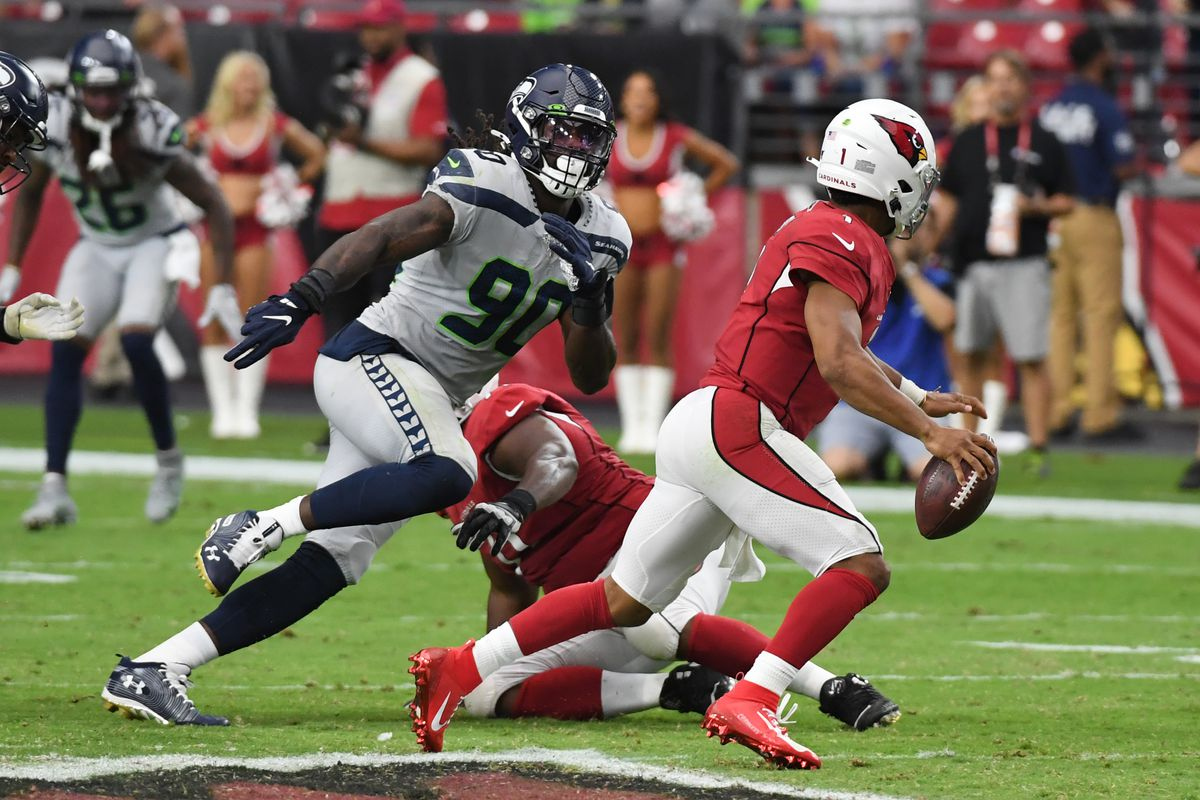 Jadeveon Clowney of the Seattle Seahawks chases Kyler Murray of the Arizona Cardinals out of the pocket during the second half of a game at State Farm Stadium on September 29, 2019 in Glendale, Arizona.