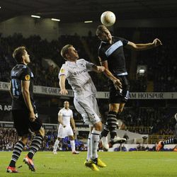 Lazio's Miroslav Klose, right, of Germany and Tottenham Hotspur's Gylfi Sigurdsson, center, fight for the ball during a Europa League Group J soccer match at White Hart Lane ground in London, Thursday, Sept. 20, 2012. The match ended 0-0.