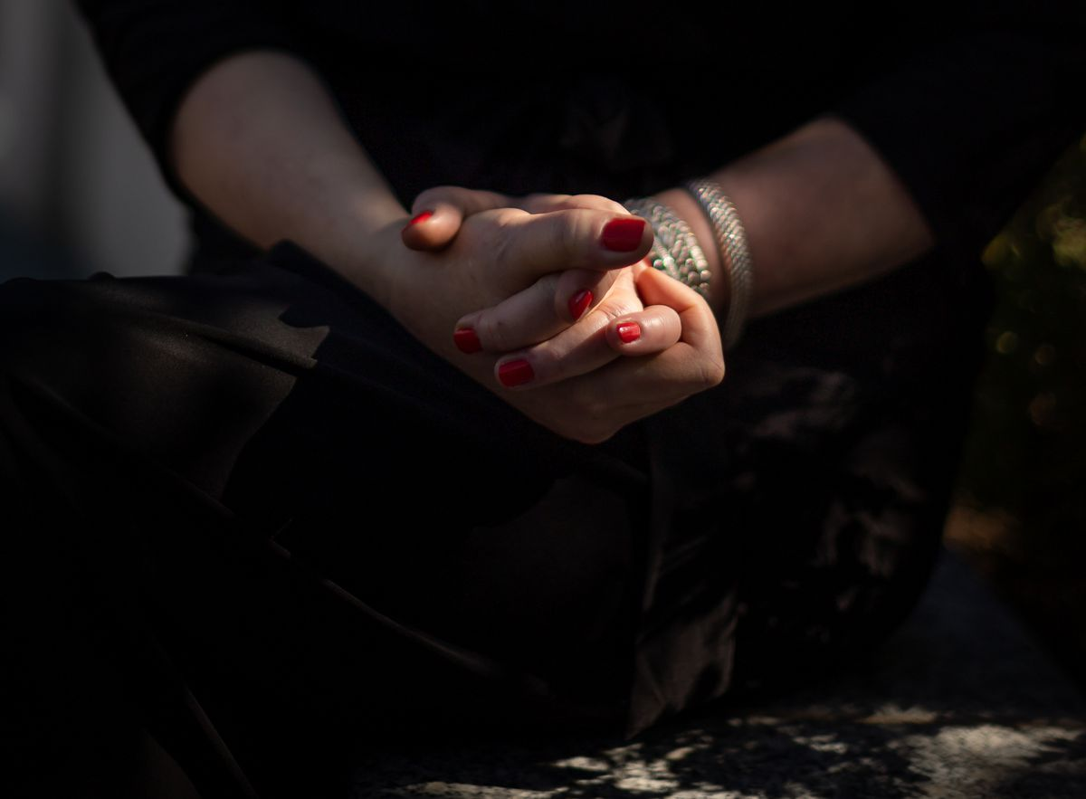 Sharon Weeks clasps her hands tightly while speaking about the killing of her sister and niece to journalists at the Capitol in Salt Lake City on Wednesday, Sept. 15, 2021. Weeks' sister, Brenda Lafferty, and Brenda's 15-month-old daughter, Erica, were killed by brothers Ron and Dan Lafferty, Brenda's brothers-in-law, in 1984.