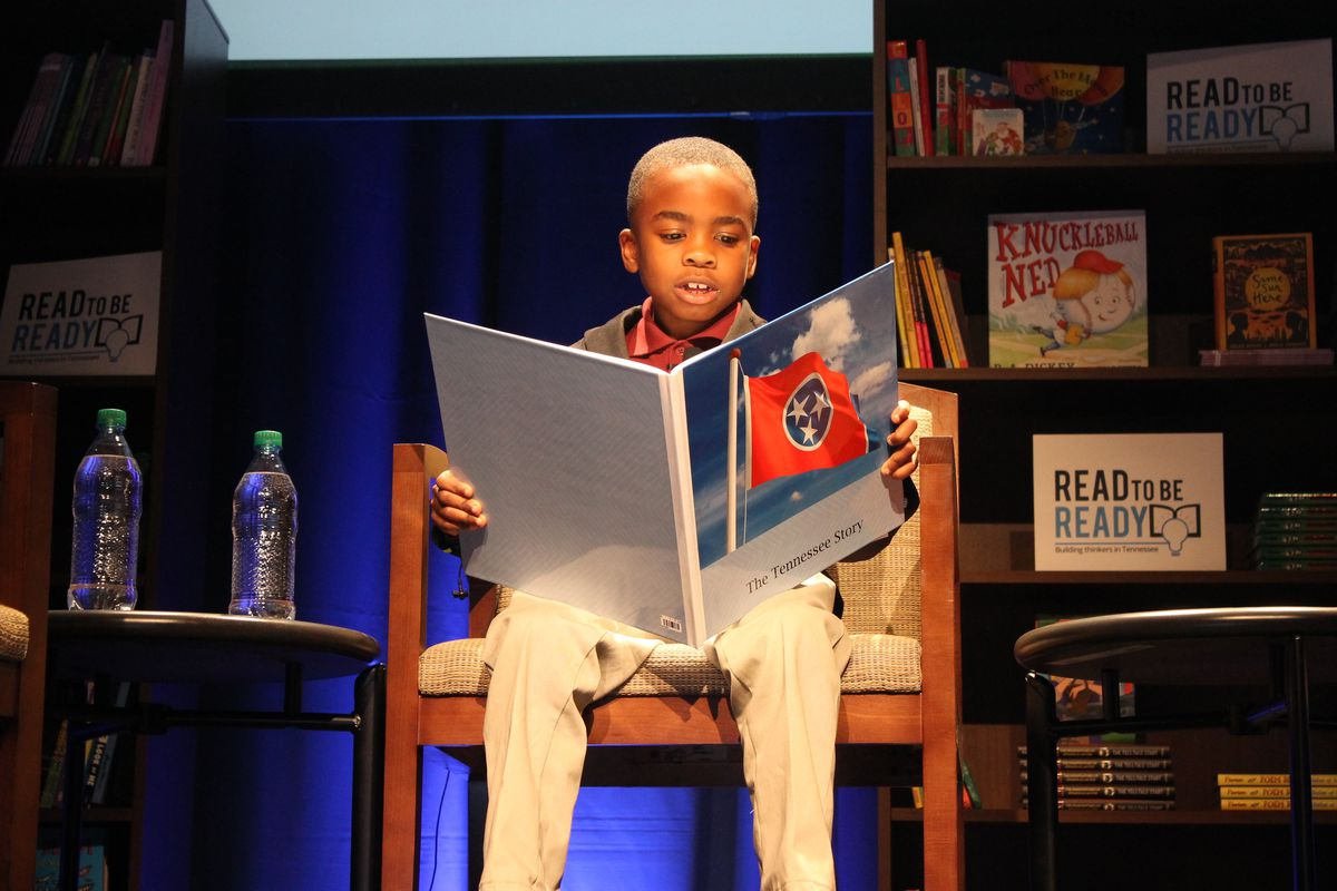 """Nashville first-grader John Little reads a story at the 2016 kickoff of Tennessee's """"Read to be Ready"""" initiative."""