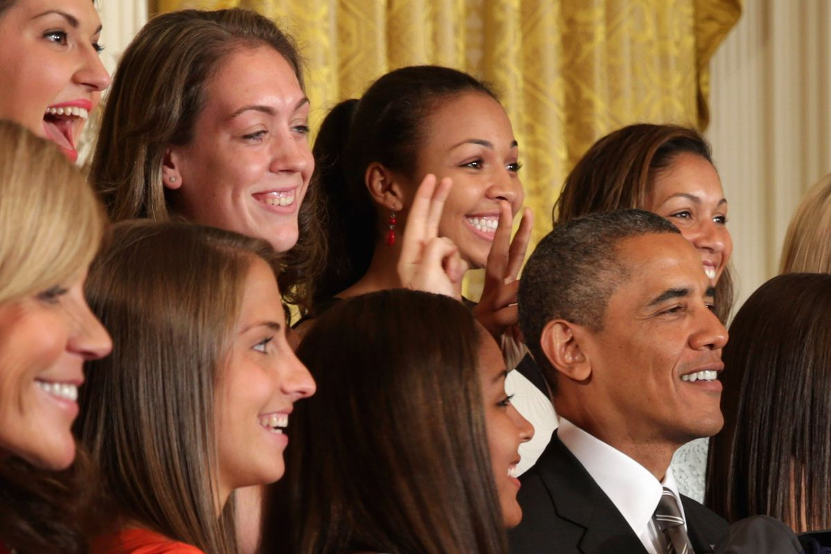 Stefanie Dolson and Kiah Stokes give President Barack Obama bunny ears during the national champion UConn women's basketball team's visit to the White House on Wednesday.