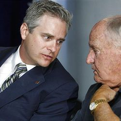 WCC Commissioner Jamie Zaninovich (left) talks wtih former BYU football coach LaVell Edwards.  Both were present as BYU officials announced going independent in football and joining the WCC for other sports as well as their contract with ESPN Wednesday.