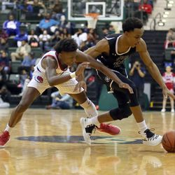 Curie's Dajuan Gordon (3) and Orr's Demarius Splunge (24) chase the loose ball in their CPS semi final game at Chicago State University, Friday, February 15, 2019. | Kevin Tanaka/For the Sun Times