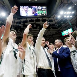 Olympus celebrates its win over Corner Canyon the 5A basketball championship in the Jon M. Huntsman Center at the University of Utah on Saturday, March 3, 2018.