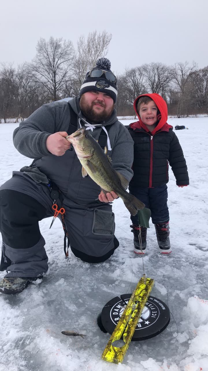 Mike Dudas front) and Logan Borscha found good ice fishing on Wampum Lake.<br>Provided