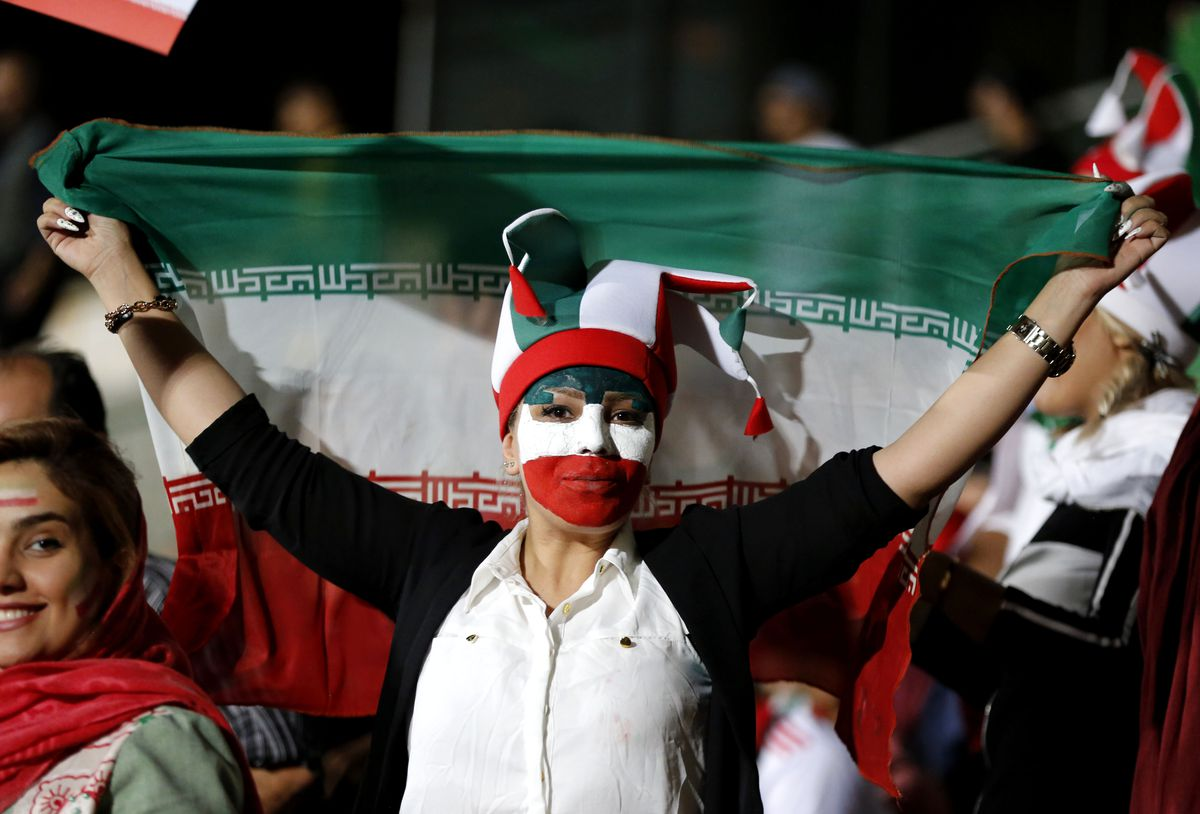 An Iranian woman watches the World Cup Group B soccer match between Portugal and Iran at Azadi stadium in Tehran on June 25, 2018.