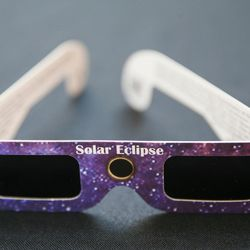 A pair of solar eclipse glasses is displayed at the John A. Moran Eye Center in Salt Lake City on Wednesday, Aug. 2, 2017. Moran Eye Center locations are giving away 1,000 free pairs of the glasses.