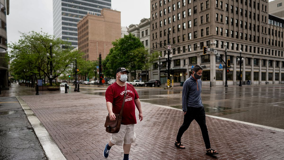 Christian Harrison and Tom Merrill take a morning walk in downtown Salt Lake City on Friday, May 1, 2020.