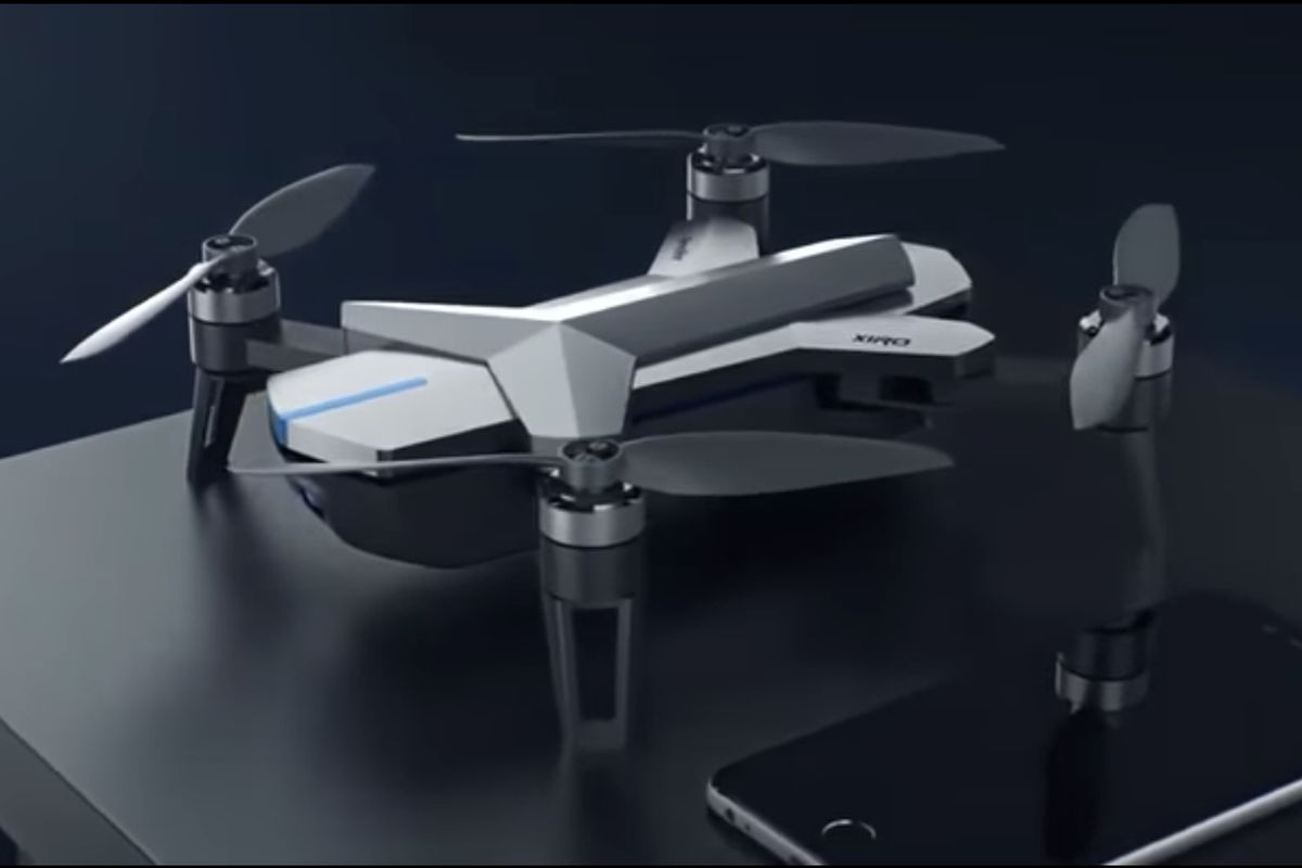 A sturdy-looking quadracopter drone on a black background
