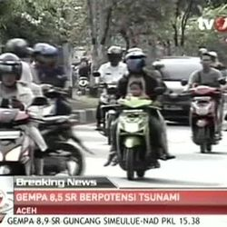 In this image made from Indonesian television TV One, people on motorcycles and cars flee after a strong earthquake hit in Aceh in Indonesia, Wednesday, April 11, 2012. A tsunami watch was issued for countries across the Indian Ocean after a large earthquake hit waters off Indonesia on Wednesday, triggering widespread panic as residents along coastlines fled to high ground in cars and on the backs of motorcycles.