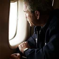 President Bush looks out the window of Air Force One over New Orleans, Wednesday, Aug. 31, 2005, to survey the damage from Hurricane Katrina.