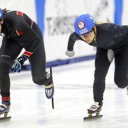 Katherine Reutter-Adamek (5) and Jessica Kooreman (3) compete in the women's 1000-meter A final race during the U.S. Olympic short track speedskating trials Sunday, Dec. 17, 2017, in Kearns, Utah. (AP Photo/Rick Bowmer)