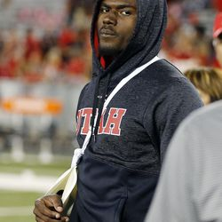 Utah Utes quarterback Tyler Huntley stands on the field with his arm in a sling against Arizona in Tucson, Arizona, on Friday, Sept. 22, 2017. Utah beat Arizona 30-24.