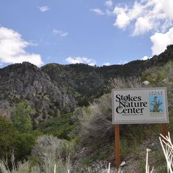 A sign marks the entrance to the River Trail that leads to Stokes Nature Center.
