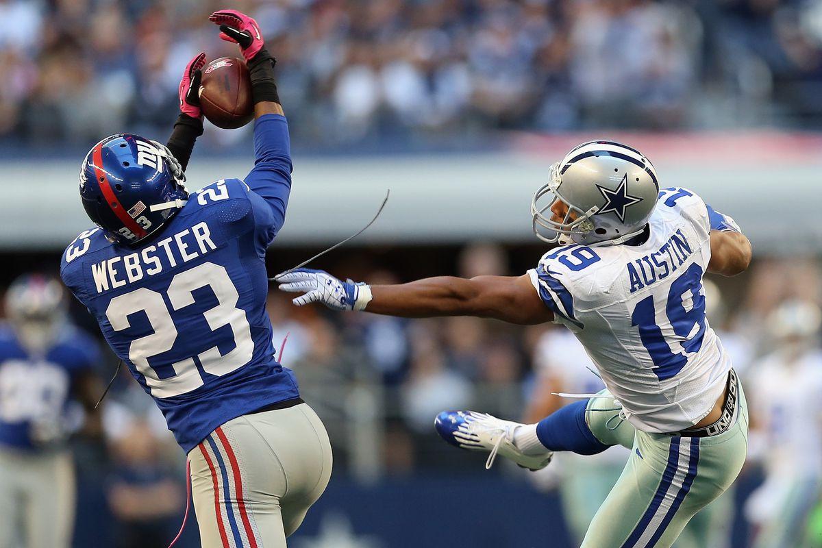 Corey Webster intercepts a pass