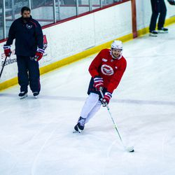 Anthony Mantha smiles as he skates past Peter Laviolette at Capitals morning skate.