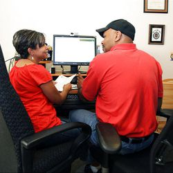 Paula and William Smith prepare their taxes at their home in Salt Lake City, Friday, March 30, 2012.