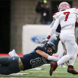 Corner Canyon's 80-year-old linebacker Luke Cahoon missed out on American quarterback Peyton Wilson (7) in the first half of the 6A football game at Rice-Eccles Stadium in Salt Lake City on Friday, November 22, 2019.