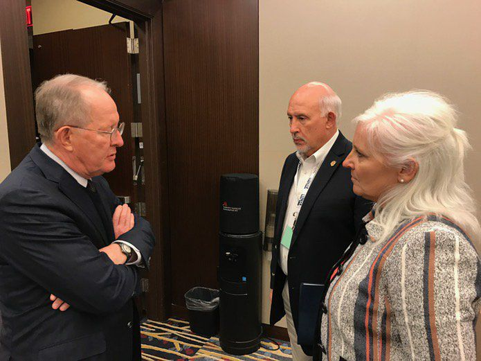Alexander (left) talks with Wayne Blair and Tammy Grissom, president and executive director of the Tennessee School Boards Association.