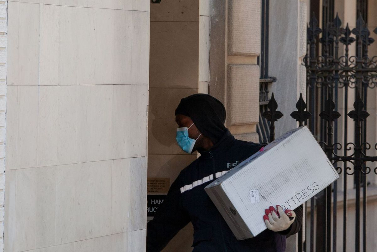 A FedEx worker delivers a package in the Upper East Side during the coronavirus outbreak.