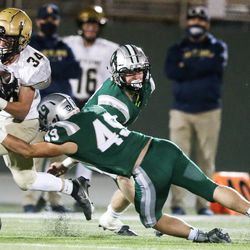 Skyline's Porter Brockman carries the ball against the Olympus defense during a high school football game at Olympus High School in Holladay on Friday, Oct. 16, 2020.