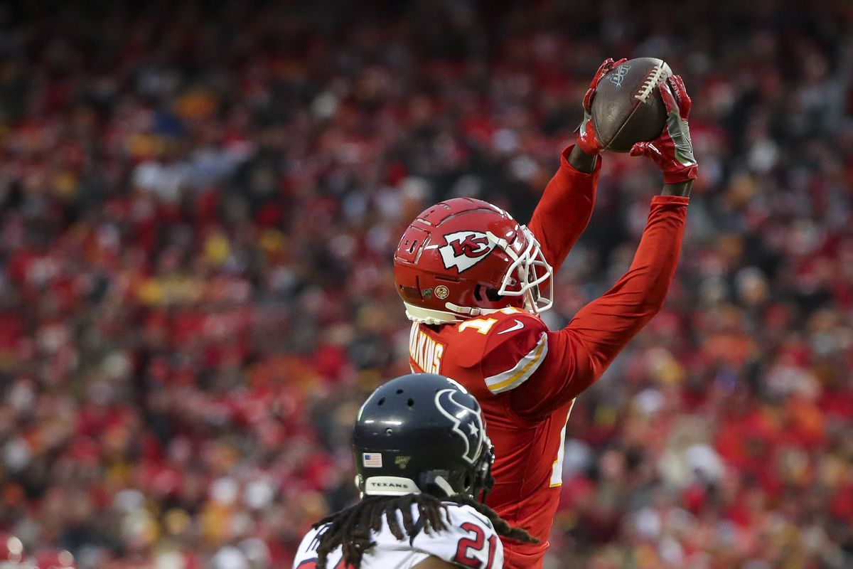 Kansas City Chiefs wide receiver Sammy Watkins catches a pass in front of Houston Texans cornerback Bradley Roby during the third quarter in a AFC Divisional Round playoff football game at Arrowhead Stadium.