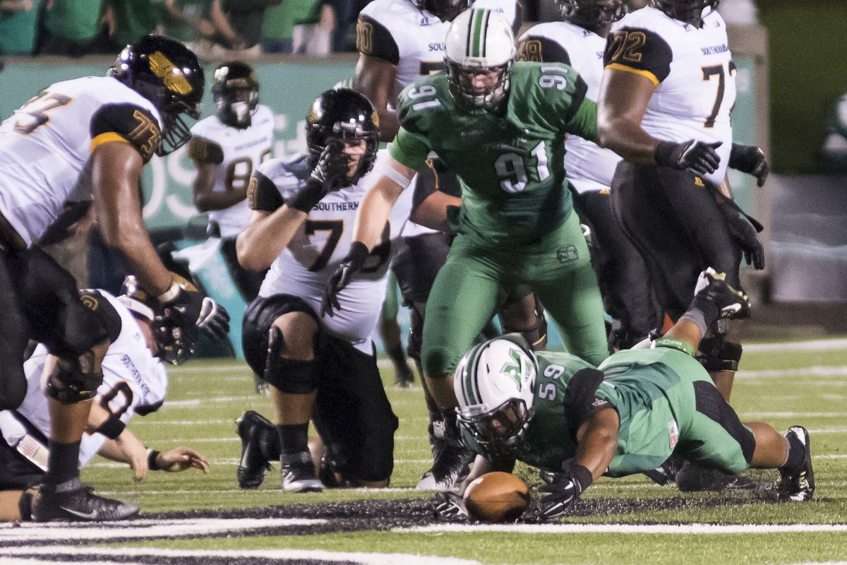 Marshall's Gary Thompson (59) recovers a fumble vs Southern Miss.