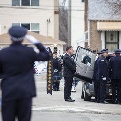 Officers salute the casket of Chicago Police Officer John P. Rivera. | Ashlee Rezin/Sun-Times