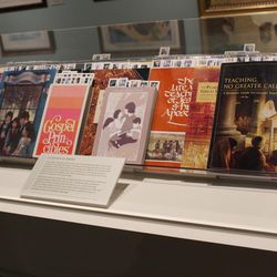 The manuals on display all contain the artwork of Harry Anderson.